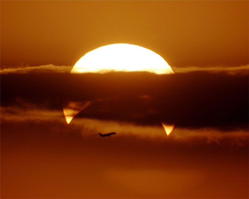 airplaine crosses partial solar eclipse Picture of the Day: Flyby Eclipse