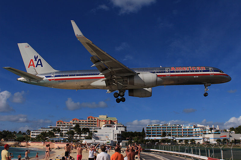 beach with planes flying directly overhead