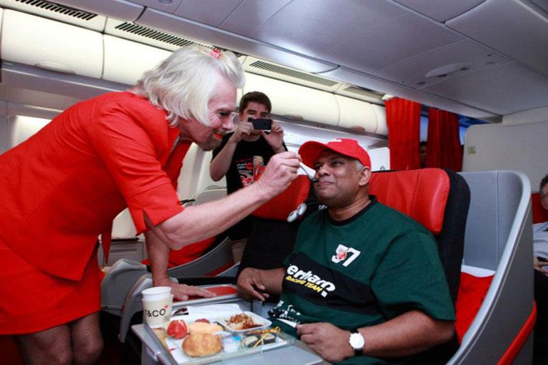 richard branson loses bet dresses as a female stewardess (9)