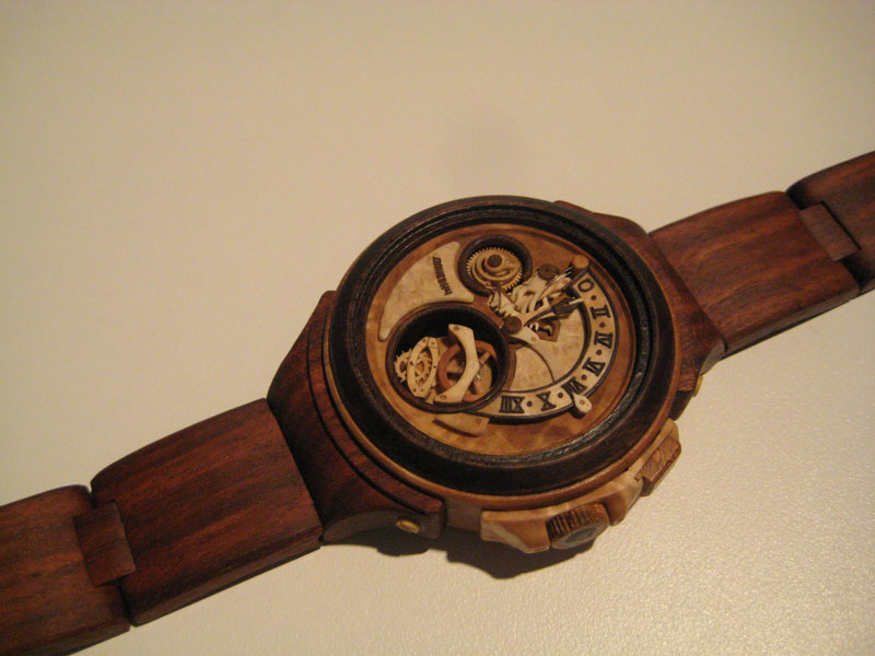 functional watches made out of wood by valerii danevych 2 This Astronomical Watch Shows Our Solar System Orbiting the Sun