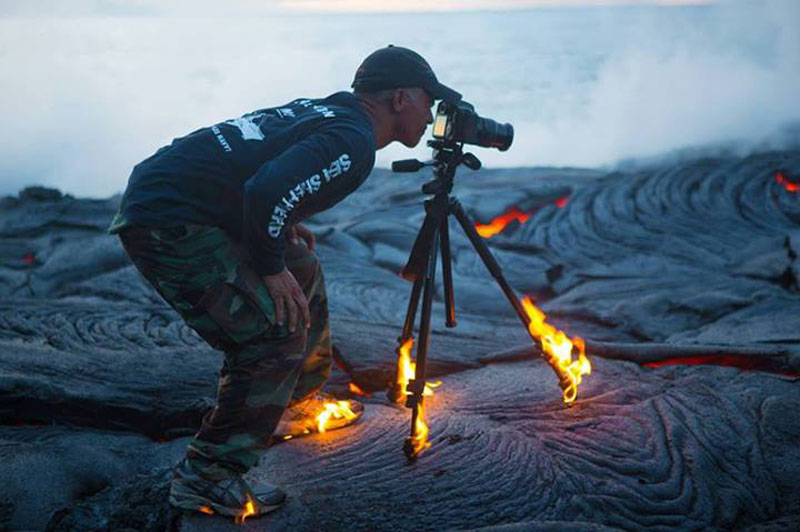 kawika-singson-standing-on-lava-shoes-tripod-on-fire