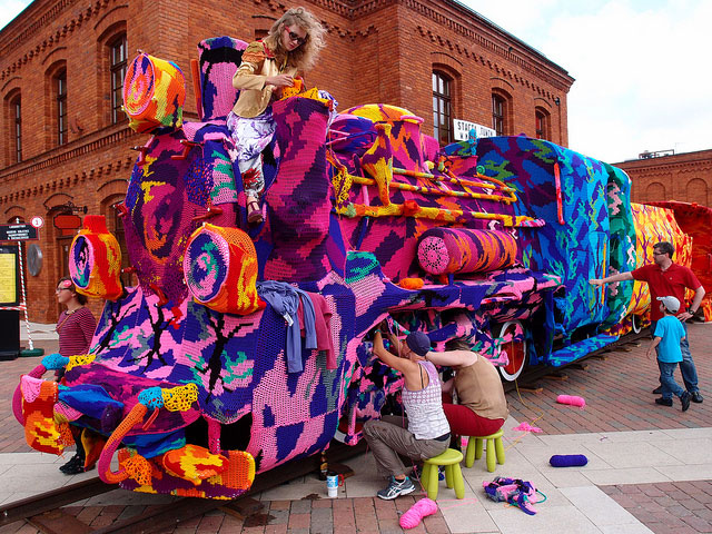 crocheted locomotive lodz poland by artist olek 9 Building Sized Street Art Portraits by Natalia Rak