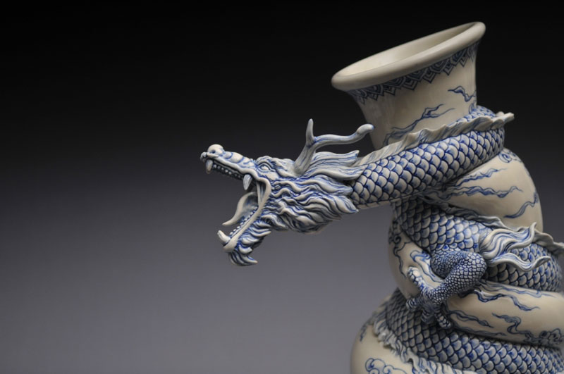 Johnson tsang sculpts a dragon strangling a porcelain vase for Cool ceramic art