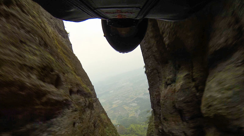 Here's What Wingsuit Flying Through a 20 ft Gap at 100 mph Looks Like