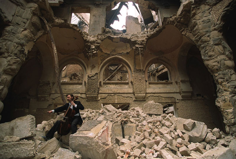 cellist of sarajevo vedran smailovic playing in partially destroyed national library 1992 Picture of the Day: Make Music Not War
