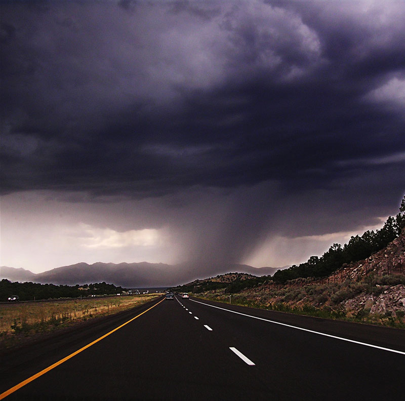 distant rain cloud on highway 21 Terrifyingly Beautiful Photos of Incoming Storm Clouds