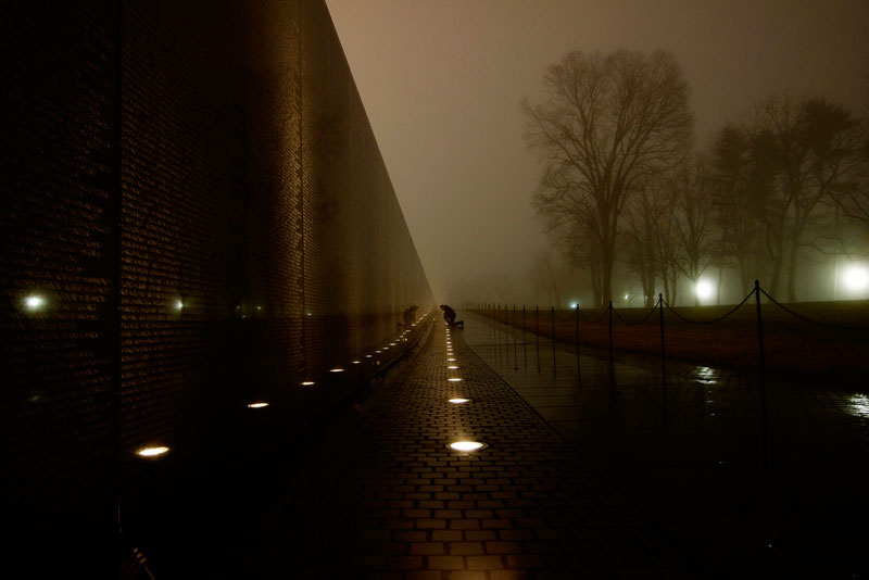 man crouched at vietnam memorial washington Picture of the Day: Always Remembered