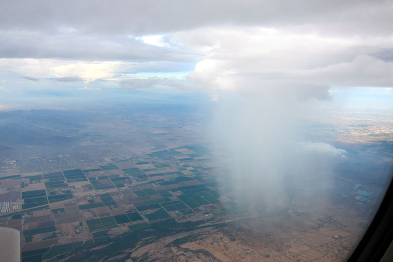 rain cloud seen from airplane window 21 Terrifyingly Beautiful Photos of Incoming Storm Clouds