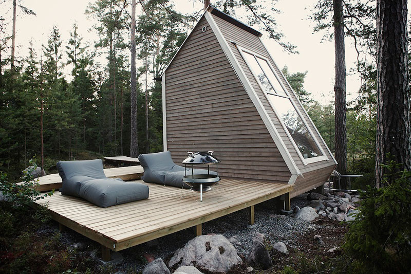 nido hut cabin in woods finland by robin falck 1 A Grotto Sauna on the Lake