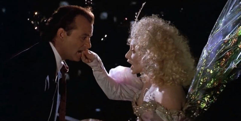 scrooged-ghost-of-christmas-present-grabbing-bill-murray's-lip