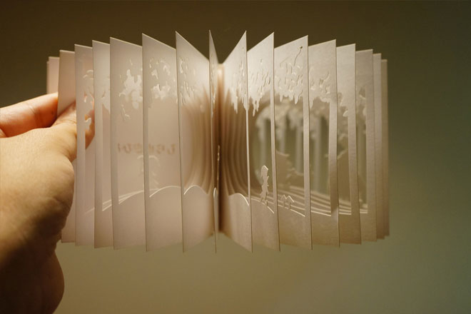 Artist designs books that fan out into 360 degree stories for Buch design