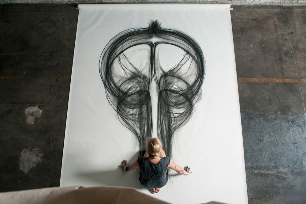 Artist uses entire body to create larger than life for Body movement drawing