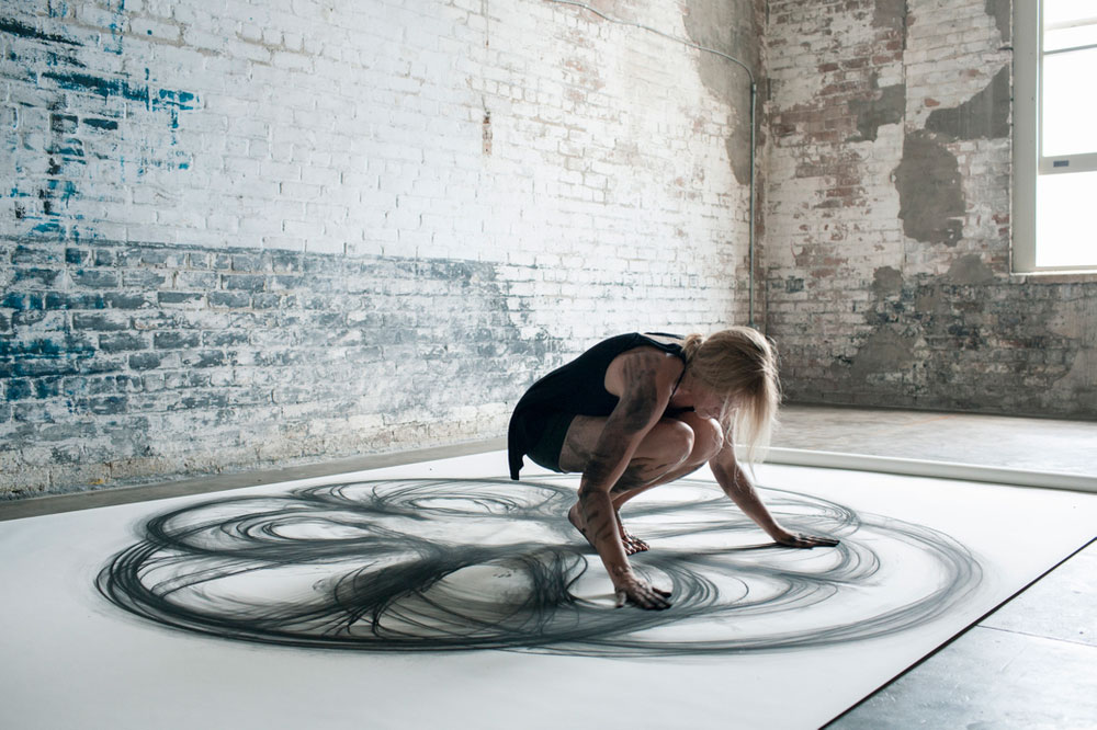 heather hansen uses entire body to create larger than life charcoal drawings 8 Light Bending Dance Performance Will Touch Your Soul