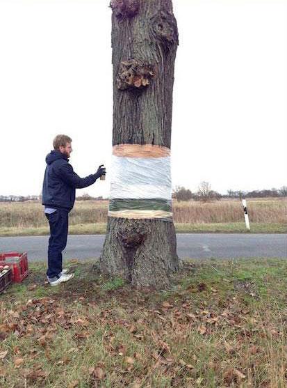 levitating tree street art illusion by daniel siering and mario shu (6)