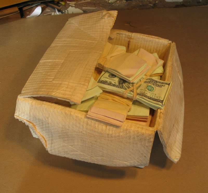 randall rosenthal carves a block of wood into a box of money (12)