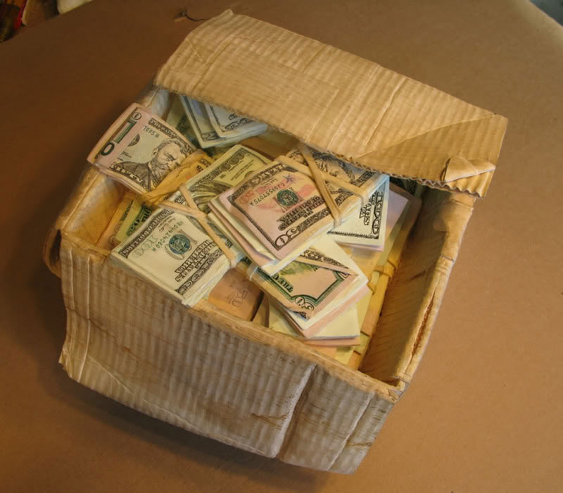randall rosenthal carves a block of wood into a box of money (14)