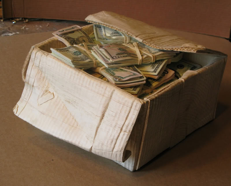randall rosenthal carves a block of wood into a box of money (15)