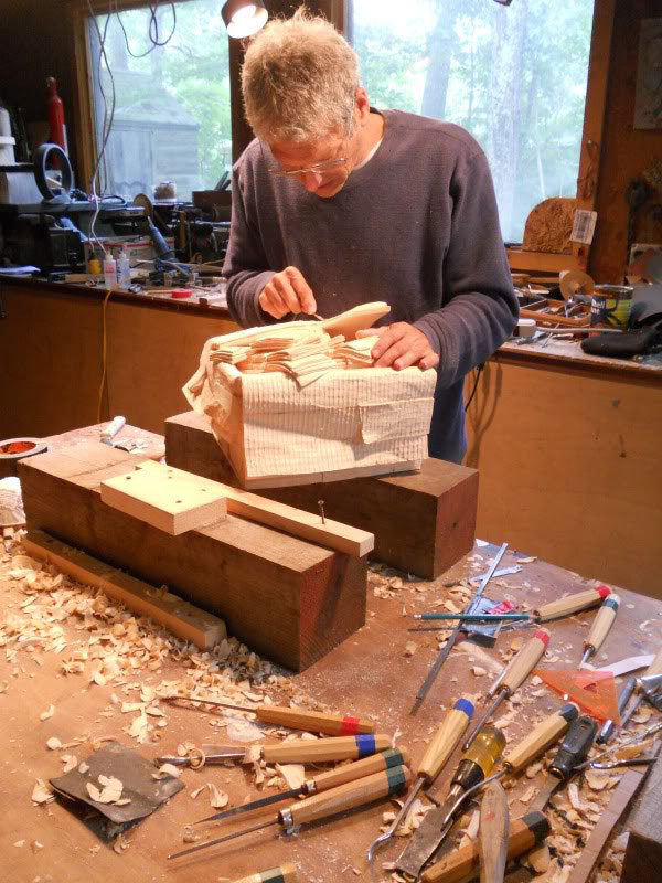 randall rosenthal carves a block of wood into a box of money (18)