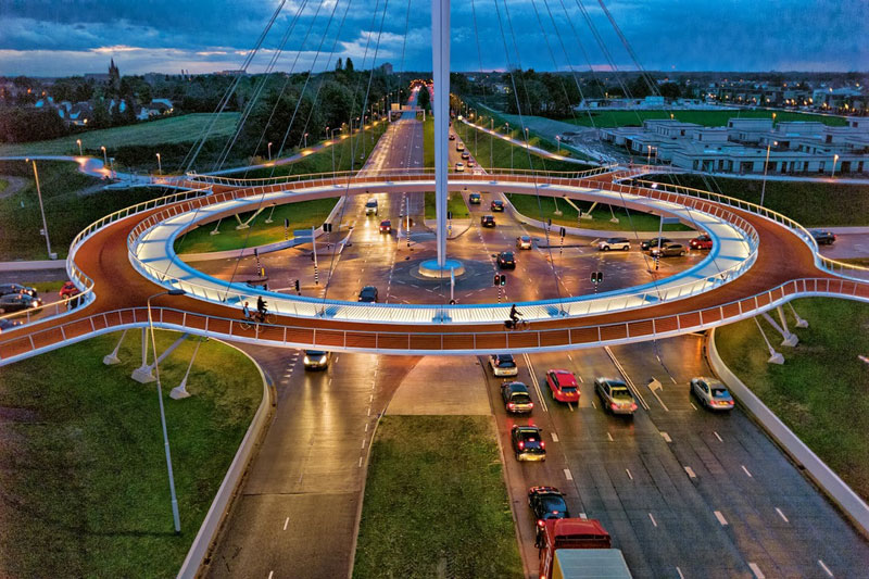worlds first suspended bicycle roundabout hovenring by ipv delft netherlands 1 A Grotto Sauna on the Lake