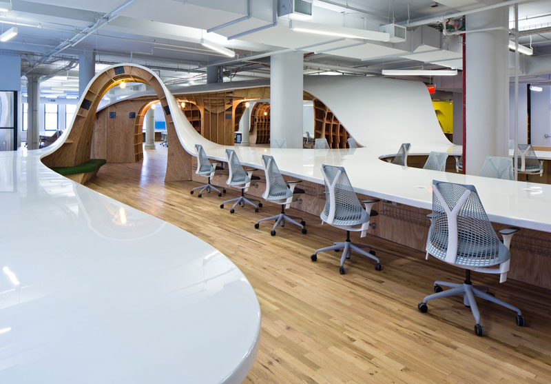 This 1 100 ft long office desk seats all 125 employees for Marketing for architects and designers