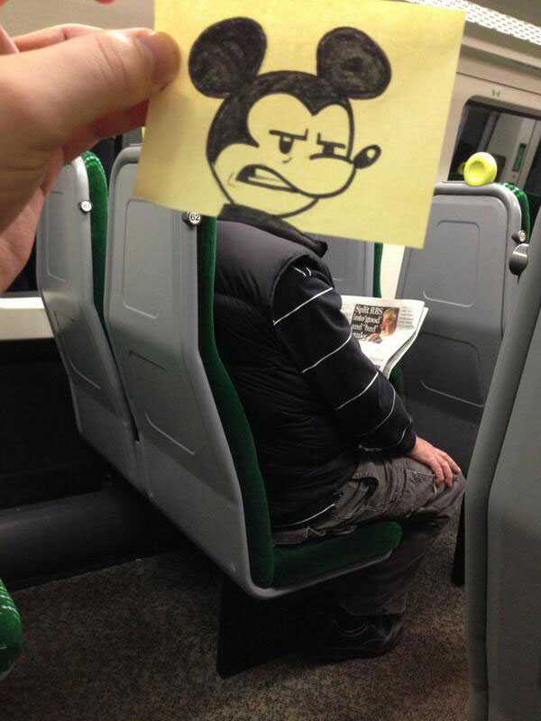 october jones gives people cartoon faces on train ride to work (1)