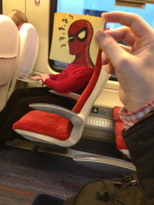 october jones gives people cartoon faces on train ride to work 12 Employee Uses 8,024 Post Its to Turn Drab Office Walls Into Giant Superhero Murals
