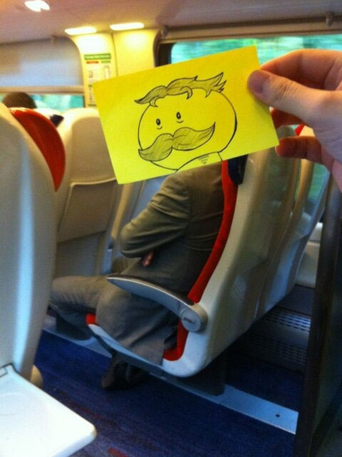 october jones gives people cartoon faces on train ride to work (8)