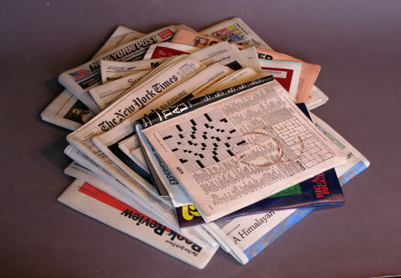 A Block of Wood Carved Into a Stack of Papers and Magazines