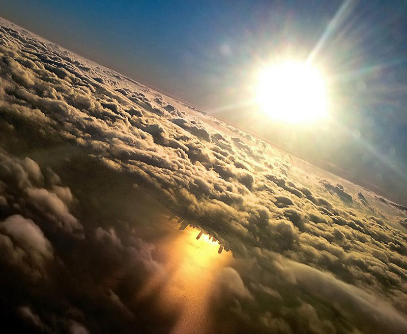 chicago reflected in lake michigan from an airplane by mark hersch 17 Satellite Photos Around the World that Will Change Your Perspective