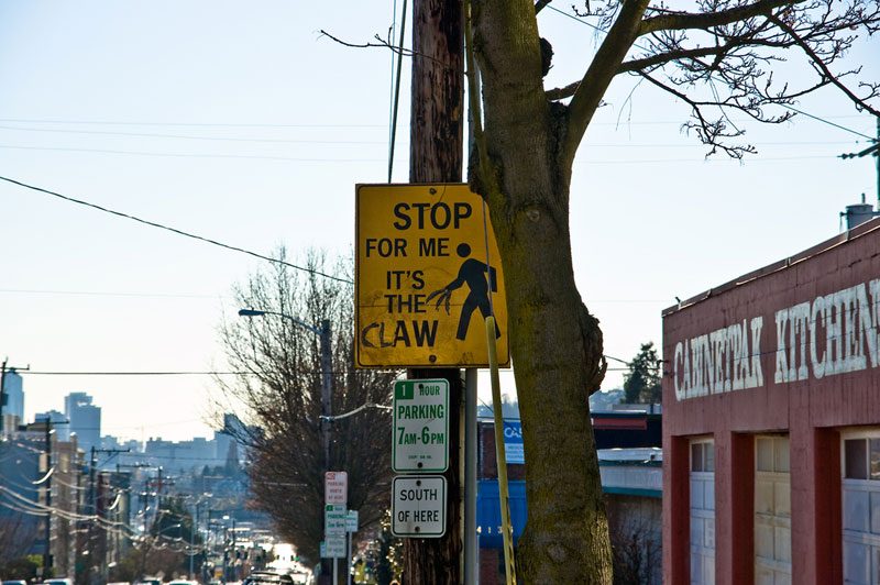 it's the claw funny street sign