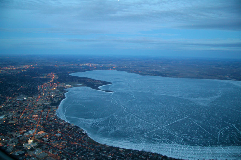 lake mendota frozen from an airplane aerial view from above