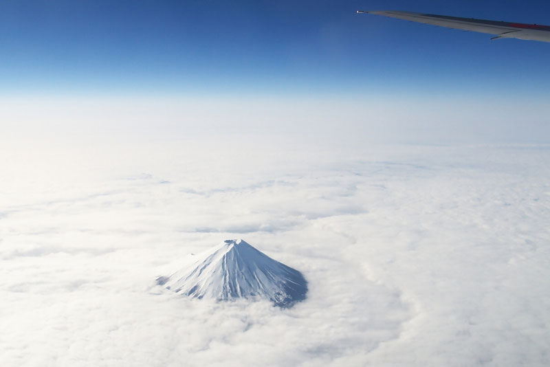 mount fuji from an airplane above the clouds