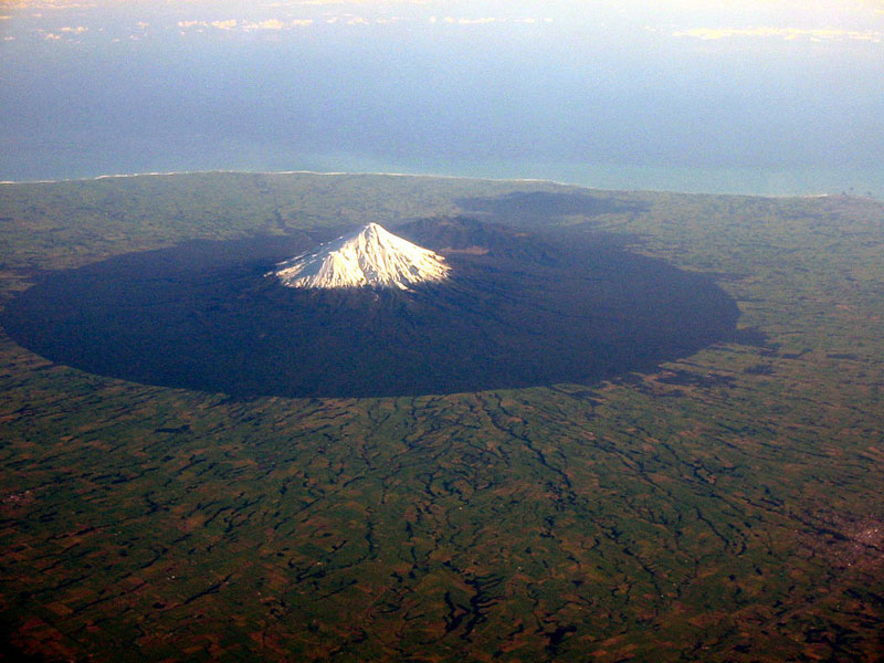 mount taranaki volcano from an airplane aerial from above