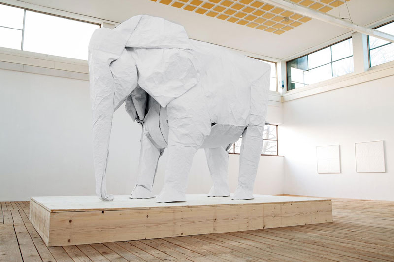 sipho mabona folds a life sized origami white elephant from a single sheet of paper 2 A Block of Wood Carved Into a Stack of Papers and Magazines