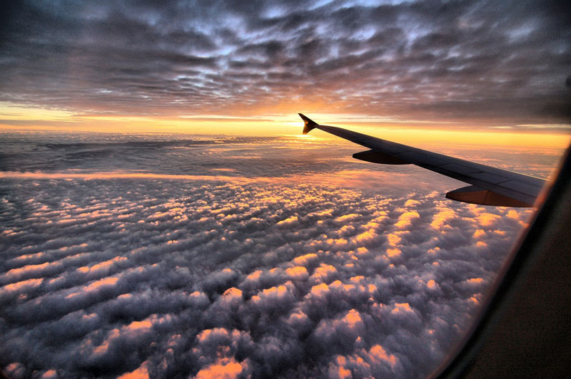 sunset above the clouds from an airplane