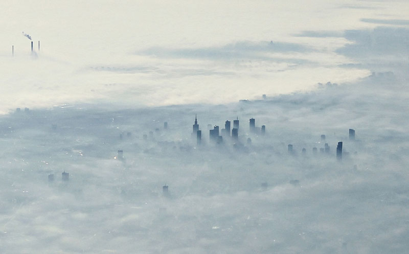 warsaw poland covered in fog from an airplane aerifal from above