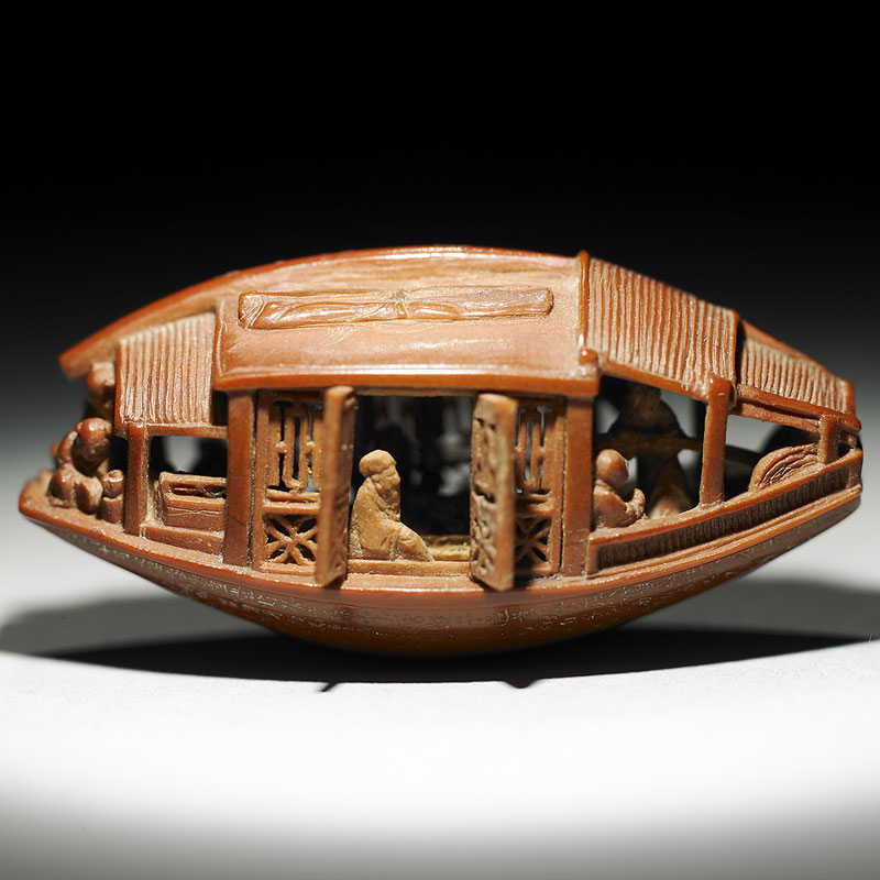 This is an Olive Pit. It was Carved in 1737