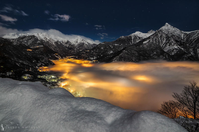CHIAVENNA italy fog illuminated at night