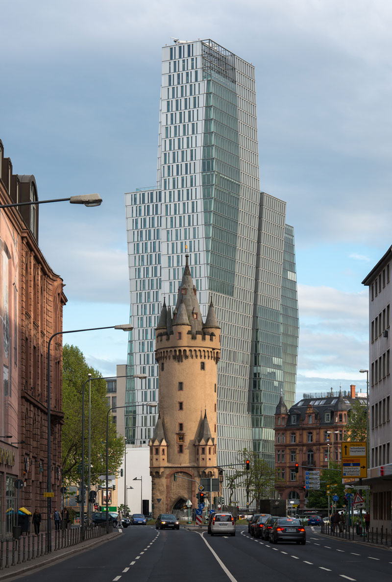 old tower in front of modern high rise frankfurt germany (1)