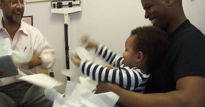 doctor makes baby laugh while getting shots