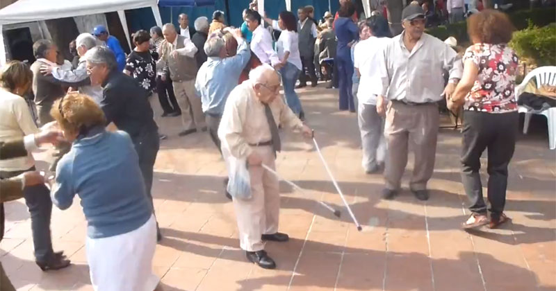 old man with two canes dancing