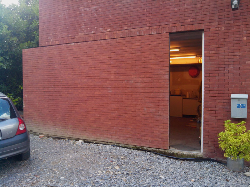 Picture of the day the sneaky sliding brick wall door for Sliding exterior walls