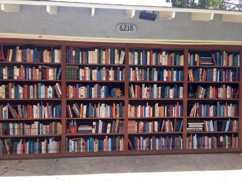 Picture of the Day: Giant Bookcase Painted on Garage Door