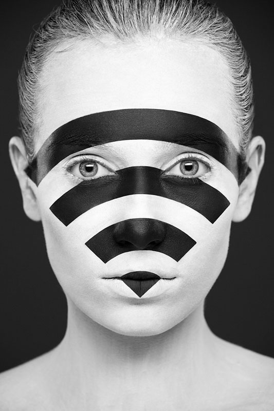 Black and white portraits of faces painted black and white 3