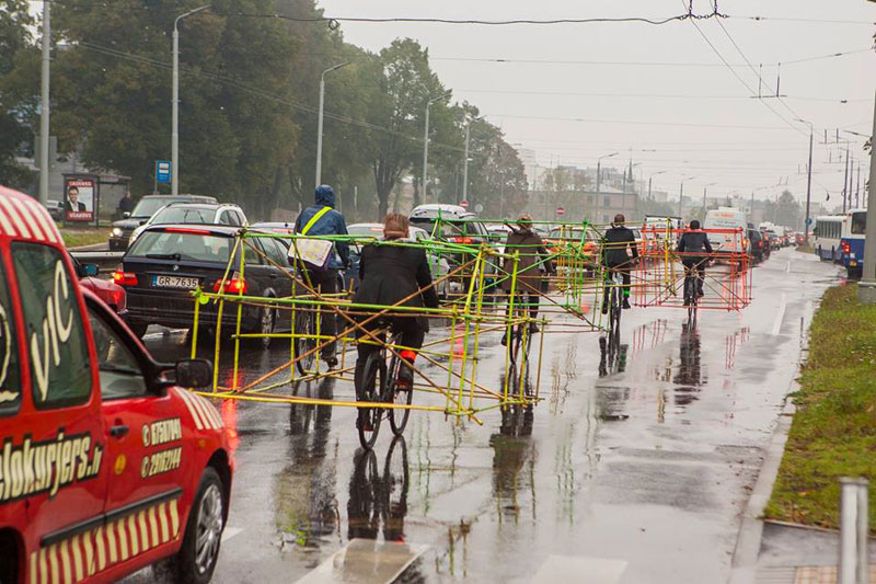 latvian cyclists demonstrate bikes taking up as much space as cars (1)