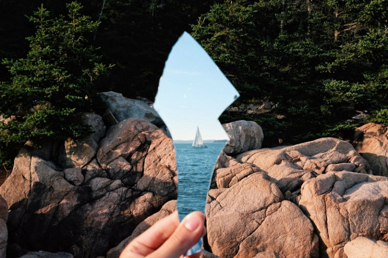 Sailboat Reflected in Broken Mirror