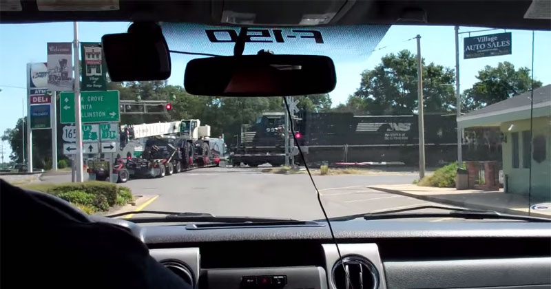 Amateur Footage Shows Train Crashing Into 18-Wheeler Stuck ...