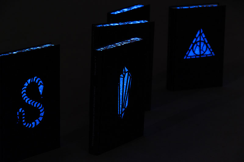 New Harry Potter Book Covers Glow In The Dark ~ Artist designs glow in the dark harry potter books with