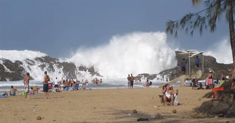 This beach has a natural rock barrier when ocean waves crash things
