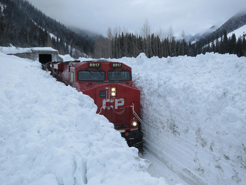 train going through huge snow wall in canada The Top 50 Pictures of the Day for 2015